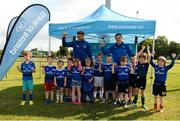 18 July 2019; Leinster players Adam Byrne and Scott Penny with participants during the Bank of Ireland Leinster Rugby Summer Camp at Seapoint Rugby Club in Glenageary, Dublin. Photo by Harry Murphy/Sportsfile
