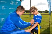 18 July 2019; Leinster player Scott Penny with participants during the Bank of Ireland Leinster Rugby Summer Camp at Seapoint Rugby Club in Glenageary, Dublin. Photo by Harry Murphy/Sportsfile