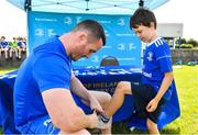 18 July 2019; Leinster player Peter Dooley signs autographs for participants during the Bank of Ireland Leinster Rugby Summer Camp at Portlaoise RFC in Portlaoise, Co Laois. Photo by Sam Barnes/Sportsfile