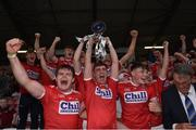 18 July 2019; Cork captain Peter O'Driscoll lifts the cup alongside his team-mates following the EirGrid Munster GAA Football U20 Championship Final match between Cork and Kerry at Páirc Ui Rinn in Cork. Photo by Matt Browne/Sportsfile
