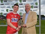 18 July 2019; Mark Cronin of Cork receives the Man of the Match Award from EirGrid Chairman John O'Connor following the EirGrid Munster GAA Football U20 Championship Final match between Cork and Kerry at Páirc Ui Rinn in Cork. Photo by Matt Browne/Sportsfile