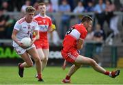 14 July 2019; Tiarnán Quinn of Tyrone gets past Dara Rafferty of Derry during the EirGrid Ulster GAA Football U20 Championship Final match between Derry and Tyrone at Athletic Grounds in Armagh. Photo by Piaras Ó Mídheach/Sportsfile
