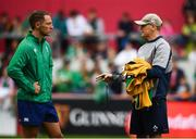 19 July 2019; Ireland head coach Joe Schmidt, right, speaks with referee Andrew Brace during an Ireland Rugby open training session at Thomond Park in Limerick. Photo by David Fitzgerald/Sportsfile