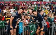 19 July 2019; Jonathan Sexton, left, and Conor Murray pose for a photo with fans following an Ireland Rugby open training session at Thomond Park in Limerick. Photo by David Fitzgerald/Sportsfile
