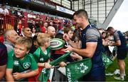 19 July 2019; Jonathan Sexton signs autographs for fans following an Ireland Rugby open training session at Thomond Park in Limerick. Photo by David Fitzgerald/Sportsfile