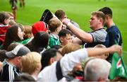 19 July 2019; Tadhg Furlong signs autographs for fans following an Ireland Rugby open training session at Thomond Park in Limerick. Photo by David Fitzgerald/Sportsfile