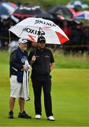19 July 2019; Shane Lowry of Ireland, with caddy Brian Martin, on the 13th green during Day Two of the 148th Open Championship at Royal Portrush in Portrush, Co Antrim. Photo by Brendan Moran/Sportsfile