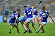 19 July 2019; Seán Lambe of Dublin in action against Laois players, from left, Alan Kinsella, Mark Barry, and Ronan Coffey during the EirGrid Leinster GAA Football U20 Championship Final match between Laois and Dublin at Bord na Móna O'Connor Park in Tullamore, Co Offaly. Photo by Piaras Ó Mídheach/Sportsfile