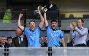 19 July 2019; Dublin joint captains Kieran Kennedy, left, and James Doran lift the cup alongside Eoin Kennedy, Chief Executive Office of EirGrid, right, after the EirGrid Leinster GAA Football U20 Championship Final match between Laois and Dublin at Bord na Móna O'Connor Park in Tullamore, Co Offaly. Photo by Piaras Ó Mídheach/Sportsfile