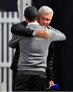 19 July 2019; Rory McIlroy of Northern Ireland is embraced by Tim Barter of Sky Sports after an interview following his round during Day Two of the 148th Open Championship at Royal Portrush in Portrush, Co Antrim. Photo by Brendan Moran/Sportsfile