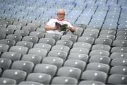 20 July 2019; A Tyrone supporter inspects the programme prior to the GAA Football All-Ireland Senior Championship Quarter-Final Group 2 Phase 2 match between Cork and Tyrone at Croke Park in Dublin. Photo by David Fitzgerald/Sportsfile