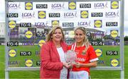 20 July 2019; Orla Finn of Cork receives the Player of the Match award from Marie Hickey, President, LGFA, following the TG4 All-Ireland Ladies Senior Football Championship Group 1 Round 2 Fixture between Cork and Cavan at TEG Cusack Park, Mullingar, Co. Westmeath Photo by Piaras Ó Mídheach/Sportsfile