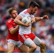 20 July 2019; Matthew Donnelly of Tyrone in action against Liam O'Donovan of Cork during the GAA Football All-Ireland Senior Championship Quarter-Final Group 2 Phase 2 match between Cork and Tyrone at Croke Park in Dublin. Photo by Ray McManus/Sportsfile