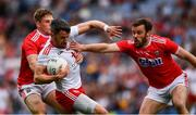 20 July 2019; Matthew Donnelly of Tyrone in action against Liam O'Donovan and James Loughrey, right, of Cork during the GAA Football All-Ireland Senior Championship Quarter-Final Group 2 Phase 2 match between Cork and Tyrone at Croke Park in Dublin. Photo by Ray McManus/Sportsfile
