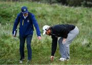 20 July 2019; JB Holmes of USA with a Rules Official during Day Three of the 148th Open Championship at Royal Portrush in Portrush, Co Antrim. Photo by Brendan Moran/Sportsfile