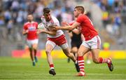 20 July 2019; Richard Donnelly of Tyrone in action against Ian Magure of Cork  during the GAA Football All-Ireland Senior Championship Quarter-Final Group 2 Phase 2 match between Cork and Tyrone at Croke Park in Dublin. Photo by David Fitzgerald/Sportsfile