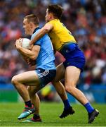 20 July 2019; Con O'Callaghan of Dublin is tackled by Sean Mullooly of Roscommon during the GAA Football All-Ireland Senior Championship Quarter-Final Group 2 Phase 2 match between Dublin and Roscommon at Croke Park in Dublin. Photo by Ray McManus/Sportsfile