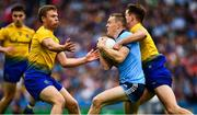 20 July 2019; Con O'Callaghan of Dublin is tackled by Sean Mullooly, right, and David Murray of Roscommon during the GAA Football All-Ireland Senior Championship Quarter-Final Group 2 Phase 2 match between Dublin and Roscommon at Croke Park in Dublin. Photo by Ray McManus/Sportsfile