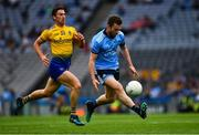20 July 2019; Jack McCaffrey of Dublin in action against Colin Compton of Roscommon during the GAA Football All-Ireland Senior Championship Quarter-Final Group 2 Phase 2 match between Dublin and Roscommon at Croke Park in Dublin. Photo by Ray McManus/Sportsfile