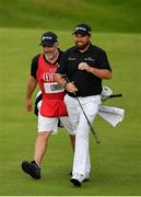 20 July 2019; Shane Lowry of Ireland with his caddy Brian Martin as they make their way to the 18th green during Day Three of the 148th Open Championship at Royal Portrush in Portrush, Co Antrim. Photo by Brendan Moran/Sportsfile