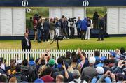 20 July 2019; Spectators watch on as Shane Lowry of Ireland conducts interviews following his round on Day Three of the 148th Open Championship at Royal Portrush in Portrush, Co Antrim. Photo by Ramsey Cardy/Sportsfile