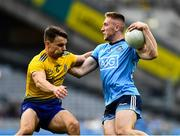 20 July 2019; Paddy Small of Dublin is tackled by Conor Hussey of Roscommon during the GAA Football All-Ireland Senior Championship Quarter-Final Group 2 Phase 2 match between Dublin and Roscommon at Croke Park in Dublin. Photo by Ray McManus/Sportsfile
