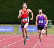 20 July 2019; Cathal Crosbie of Ennis Track AC leads his team home to win the Men's Division 1 4x400m relay from second place Chris St Clare Johnson of the Wexford County team during the AAI National League Final at Tullamore Harriers Stadium in Tullamore, Co. Offaly. Photo by Matt Browne/Sportsfile