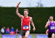 20 July 2019; Cathal Crosbie of Ennis Track AC celebrates after leading his team home to win the Men's Division 1 4x400m relay from second place Chris  St Clare Johnson of the Wexford County team during the AAI National League Final at Tullamore Harriers Stadium in Tullamore, Co. Offaly. Photo by Matt Browne/Sportsfile
