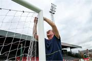21 July 2019; Bohemians groundsman Noel Cosgrove hangs the goal nets ahead of the SSE Airtricity League Premier Division match between Bohemians and St Patrick's Athletic at Dalymount Park in Dublin. Photo by Michael P Ryan/Sportsfile