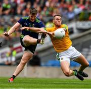 21 July 2019; Cillian O'Connor of Mayo has his shot blocked by Bryan Menton of Meath during the GAA Football All-Ireland Senior Championship Quarter-Final Group 1 Phase 2 match between Mayo and Meath at Croke Park in Dublin. Photo by Ray McManus/Sportsfile