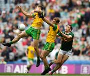 21 July 2019; Hugh McFadden of Donegal, left, and team-mate Stephen McMenamin in action against David Clifford of Kerry during the GAA Football All-Ireland Senior Championship Quarter-Final Group 1 Phase 2 match between Kerry and Donegal at Croke Park in Dublin. Photo by David Fitzgerald/Sportsfile