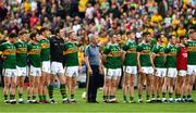 21 July 2019; Kerry manager Peter Keane  stands with his players during the playing of the National Anthem before the GAA Football All-Ireland Senior Championship Quarter-Final Group 1 Phase 2 match between Kerry and Donegal at Croke Park in Dublin. Photo by Ray McManus/Sportsfile