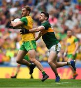 21 July 2019; Stephen McMenamin of Donegal in action against Paul Geaney of Kerry during the GAA Football All-Ireland Senior Championship Quarter-Final Group 1 Phase 2 match between Kerry and Donegal at Croke Park in Dublin. Photo by David Fitzgerald/Sportsfile