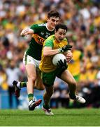 21 July 2019; Eoin McHugh of Donegal  in action against Seán O'Shea of Kerry during the GAA Football All-Ireland Senior Championship Quarter-Final Group 1 Phase 2 match between Kerry and Donegal at Croke Park in Dublin. Photo by Ray McManus/Sportsfile
