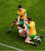 21 July 2019; Gavin White of Kerry in action against Ryan McHugh, left, and Niall O'Donnell of Donegal during the GAA Football All-Ireland Senior Championship Quarter-Final Group 1 Phase 2 match between Kerry and Donegal at Croke Park in Dublin. Photo by Daire Brennan/Sportsfile