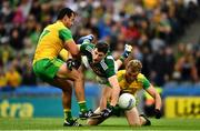 21 July 2019; Paul Geaney of Kerry in action against Frank McGlynn, left, and Stephen McMenamin of Donegal during the GAA Football All-Ireland Senior Championship Quarter-Final Group 1 Phase 2 match between Kerry and Donegal at Croke Park in Dublin. Photo by Ray McManus/Sportsfile