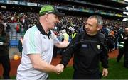 21 July 2019; Donegal manager Declan Bonner, left, and Kerry manager Peter Keane shake hands following the GAA Football All-Ireland Senior Championship Quarter-Final Group 1 Phase 2 match between Kerry and Donegal at Croke Park in Dublin. Photo by David Fitzgerald/Sportsfile