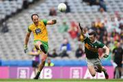 21 July 2019; Michael Murphy of Donegal scores a late point despite Paul Murphy of Kerry during the GAA Football All-Ireland Senior Championship Quarter-Final Group 1 Phase 2 match between Kerry and Donegal at Croke Park in Dublin. Photo by David Fitzgerald/Sportsfile