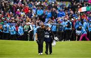 21 July 2019; Shane Lowry of Ireland celebrates with caddy Brian Martin as they walk onto the 18th green on their way to winning The Open Championship on Day Four of the 148th Open Championship at Royal Portrush in Portrush, Co Antrim. Photo by Brendan Moran/Sportsfile Photo by Brendan Moran/Sportsfile