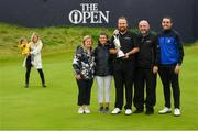 21 July 2019; Shane Lowry of Ireland celebrates with his parents Bridget and Brendan Lowry, brother Alan and sister Sinead with the Claret Jug, with his wife Wendy Honner and daughter Iris, left, after winning The Open Championship on Day Four of the 148th Open Championship at Royal Portrush in Portrush, Co Antrim. Photo by Ramsey Cardy/Sportsfile