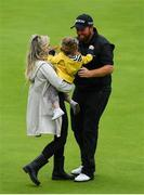 21 July 2019; Shane Lowry of Ireland celebrates with his wife Wendy Honner and daughter Iris after winning The Open Championship on Day Four of the 148th Open Championship at Royal Portrush in Portrush, Co Antrim. Photo by Brendan Moran/Sportsfile Photo by Brendan Moran/Sportsfile