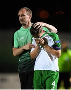 21 July 2019; Republic of Ireland captain Lee O'Connor who picked up a suspension for the semi-final is consoled by assistant coach Colin Healy during the 2019 UEFA U19 European Championship Finals group B match between Republic of Ireland and Czech Republic at the FFA Academy Stadium in Yerevan, Armenia. Photo by Stephen McCarthy/Sportsfile