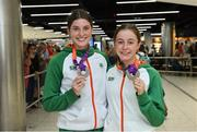 22 July 2019; Kate O'Connor with her silver medal from the Women's Heptathlon event, left, and Sarah Healy with her silver medal from the Women's 1500m event on the return home of Team Ireland from the European Athletics U20 Athletics Championships  at Dublin Airport. Photo by Piaras Ó Mídheach/Sportsfile