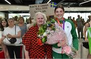 22 July 2019; Kate O'Connor, silver medal winner from the Women's Heptathlon event, is presented with flowers by President of Athletics Ireland Georgina Drumm on the return home of Team Ireland from the European Athletics U20 Athletics Championships at Dublin Airport. Photo by Piaras Ó Mídheach/Sportsfile