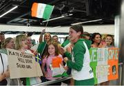 22 July 2019; Kate O'Connor, silver medal winner from the Women's Heptathlon event, with some of her supporters on the return home of Team Ireland from the European Athletics U20 Athletics Championships  at Dublin Airport. Photo by Piaras Ó Mídheach/Sportsfile
