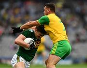 21 July 2019; Seán O'Shea of Kerry is tackled by Paul Brennan of Donegal  during the GAA Football All-Ireland Senior Championship Quarter-Final Group 1 Phase 2 match between Kerry and Donegal at Croke Park in Dublin. Photo by Ray McManus/Sportsfile