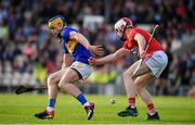 23 July 2019; Conor Bowe of Tipperary in action against Conor Callaghan of Cork during the Bord Gais Energy Munster GAA Hurling Under 20 Championship Final match between Tipperary and Cork at Semple Stadium in Thurles, Co Tipperary. Photo by Sam Barnes/Sportsfile