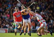 23 July 2019; Kian O'Kelly of Tipperary shoots to score their side's second goal, despite the attentions of Ger Collins, right, and Daire Connery of Cork, during the Bord Gais Energy Munster GAA Hurling Under 20 Championship Final match between Tipperary and Cork at Semple Stadium in Thurles, Co Tipperary. Photo by Sam Barnes/Sportsfile