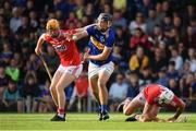 23 July 2019; Kian O'Kelly of Tipperary in action against against James Keating, left, and Sean O'Leary Hayes of Cork on his way to scoring his side's second goal during the Bord Gais Energy Munster GAA Hurling Under 20 Championship Final match between Tipperary and Cork at Semple Stadium in Thurles, Co Tipperary. Photo by Sam Barnes/Sportsfile