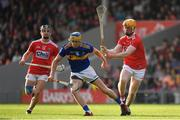 23 July 2019; Conor Bowe of Tipperary in action against James Keating, left, and Daire Connery of Cork during the Bord Gais Energy Munster GAA Hurling Under 20 Championship Final match between Tipperary and Cork at Semple Stadium in Thurles, Co Tipperary. Photo by Sam Barnes/Sportsfile